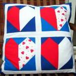 Red white and blue hearts cushion