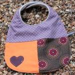 Baby bib - purple, orange bursts