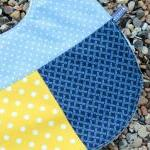 Baby bib - blue and yellow spots